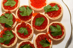 Red caviar tartlets snack food Stock Images