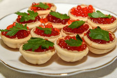 Red caviar tartlets snack food Royalty Free Stock Photography