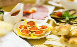 Red caviar in tartlets on white plate Stock Photography