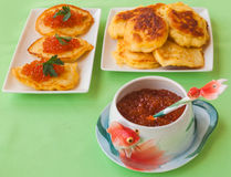 Red caviar and thick potato pancakes at Shrovetide (mass produce Stock Photos