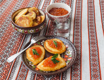 Red caviar and thick potato pancakes at Shrovetide (mass produce Stock Photography