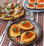 Red caviar and thick potato pancakes at Shrovetide (mass produce Royalty Free Stock Image