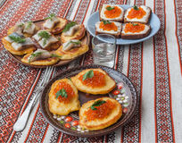 Red caviar and thick potato pancakes at Shrovetide (mass produce Stock Image