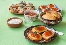 Red caviar and thick potato pancakes at Shrovetide (mass produce Royalty Free Stock Images