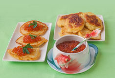 Red caviar and thick potato pancakes at Shrovetide (mass produce Stock Photo