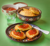Red caviar and thick potato pancakes at Shrovetide (mass produce Royalty Free Stock Photo