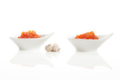 Red caviar in two bowls on white. Royalty Free Stock Photos