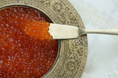 Red caviar. In vintage metal bowl on a light  background Royalty Free Stock Photos