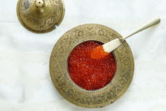 Red caviar. In vintage metal bowl on a light  background Stock Photos