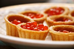 Red caviar in a waffle basket on a plate royalty free stock photo