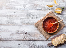 Red caviar in a wooden bowl. On old wooden table. Top view Royalty Free Stock Photography