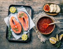 Red caviar in a wooden bowl. On old wooden table. Top view Royalty Free Stock Image
