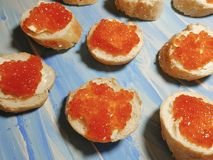 Red caviar on a wooden seafood. Red caviar on a wooden appetizer seafood stock photography