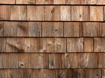 Red cedar exterior wall shingles. Rows of red cedar on an exterior wall weathered by exposure Royalty Free Stock Images