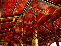 Red ceiling, Thailand. Red and gold ornate ceiling in temple, Thailand Stock Image