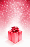 Red celebration gift box on snow background Stock Photo
