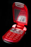 Red cell phone Stock Images