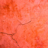 Red cement crack wall texture Stock Image