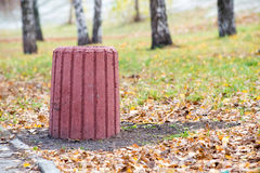 Red Cement Trash Bin in the Park Royalty Free Stock Images