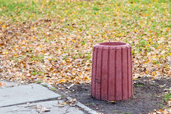 Red Cement Trash Bin in the Park Stock Image
