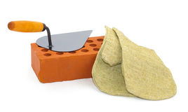 Red ceramic brick, trowel and gauntlet Royalty Free Stock Photos