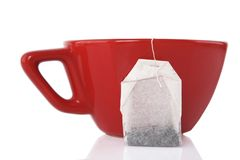 Red Ceramic cup with tea bag Royalty Free Stock Photos