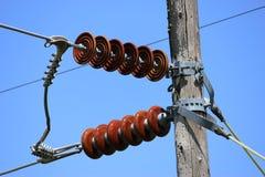 Red ceramic insulators. Red ceramic power line insulators Stock Photography