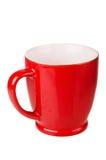Red ceramic mug. Isolated on white stock images