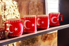 Red ceramic mugs with the image of the national flag of Turkey stock photo