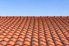 The red ceramic roof tile with sun light Stock Photos