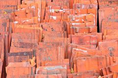 Red ceramic roof tiles. Stack of red ceramic roof tiles Royalty Free Stock Photo
