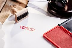 Red certified rubber stamp. On white sheet of paper. Law office stock photos