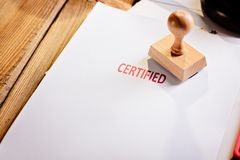 Red certified rubber stamp. On white sheet of paper. Law office stock images