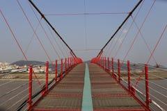Red chain bridge Stock Images