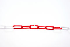 Red chain with broken element on white Royalty Free Stock Photos