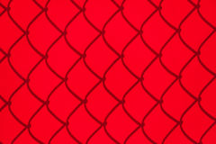 Red Chainlink Fence Shadow. Chainlink Fence Shadow on red Shade Cloth Royalty Free Stock Photo