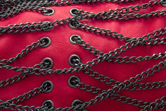 Red Chains and Leather. Close-up of chains on red leather royalty free stock image