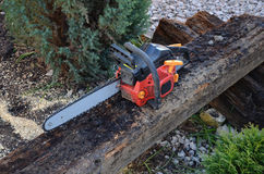 Red Chainsaw tool. Red chainsaw for home use. Fast and simple stock photography