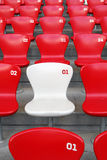 Red Chair. A white chair in middle of red chairs Royalty Free Stock Photography