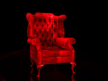 Red Chair. Old red chair on reflective surface Royalty Free Stock Photo