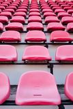Red chair. Red chairs on the miraculous. To watch a sporting event in the field Stock Photos