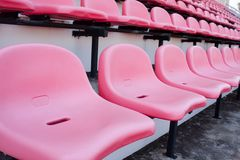 Red chair. Red chairs on the miraculous. To watch a sporting event in the field Royalty Free Stock Image
