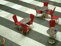 Red chair. And marble table Stock Images