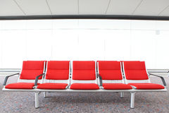 Red chair at airport Stock Images