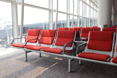 Red chair at airport Royalty Free Stock Images