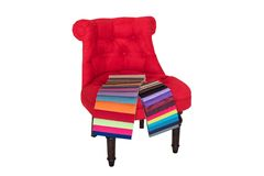Red chair in Baroque style and color samples of fabrics Stock Photo
