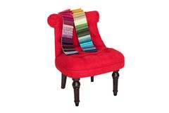 Red chair in Baroque style and color samples of fabrics Stock Photography
