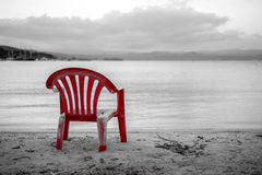 Red chair on the beach Royalty Free Stock Photos