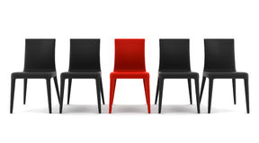 Red chair among black chairs isolated on white Stock Image