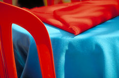 Red chair blue table. A summer bar ded chair with a blue table royalty free stock images